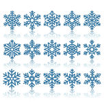 Black Flat Snowflakes Icons with Reflection  on White Royalty Free Stock Image