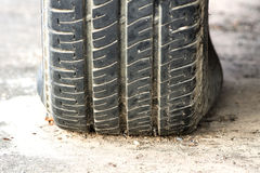 Black flat tyre - select focus Stock Photo