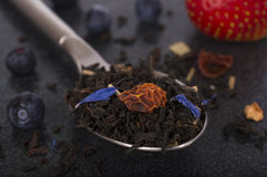 Black flavoured tea in spoon Royalty Free Stock Photography