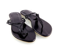 Black flip flops. Isolated on white background royalty free stock photos