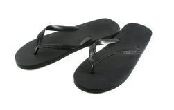 Black Flip Flops. Pair of black rubber flip flops royalty free stock photo