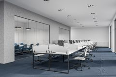 Black floor open space office corner. Black floor office interior with white walls and computer desks. A meeting room to the left. A corner. 3d rendering mock up royalty free stock image