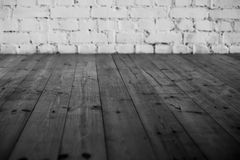 Black floor and  white brick wall background. Black wooden floor and  white brick wall background Royalty Free Stock Image