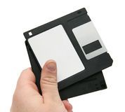 Black floppy discs in hand Royalty Free Stock Photos