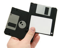 Black floppy discs in hand Stock Photos