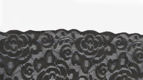 Black floral lace band background royalty free stock photo