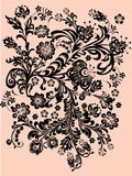 Black floral ornament on orange Stock Image