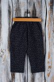 Black floral pants on hanger. Loose trousers for lounging at home or sleeping. Girls fashion Stock Image