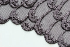 Black flower lace material texture macro shot Stock Images