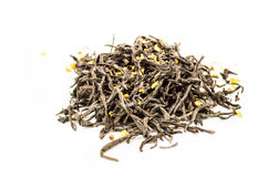 Black flower tea leaves scatter pile. Black tea leaves with flowers on the white background royalty free stock photos
