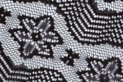 Black flowers lace material texture macro shot Royalty Free Stock Images
