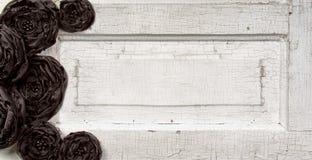 Black flowers on vintage doore. Black shabby chic flowers on vintage door Stock Images