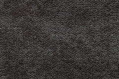 Black fluffy background of soft, fleecy cloth. Texture of light nappy textile, closeup. Stock Photography