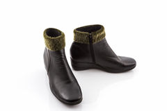 Black Fluffy woolly warm boots. Royalty Free Stock Image