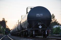 Black fluid transport cart on the rails stock photo