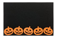 Black foam halloween mat with jack o lanterns Stock Photo