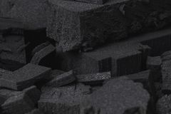 Black foam parts texture in different shapes royalty free stock image