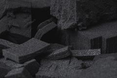 Black foam parts texture in different shapes stock photo