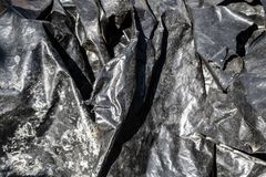 Black foil plastic surface texture royalty free stock images