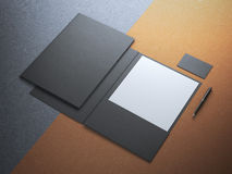 Black folder with white paper sheet Stock Images