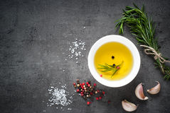 Black food background with olive oil and spices Stock Images