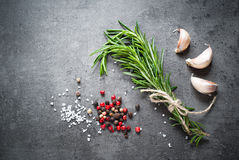 Black food background with olive oil and spices Royalty Free Stock Images