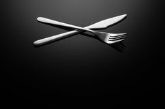 Black food background, silverware on reflective surface with copy space Stock Photo