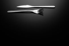 Black food background, silverware on reflective surface with copy space Royalty Free Stock Photos