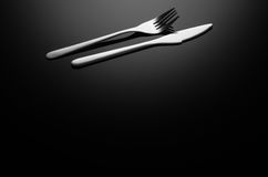 Black food background, silverware on reflective surface with copy space Royalty Free Stock Images