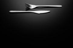 Black food background, silverware on reflective surface with copy space Stock Image