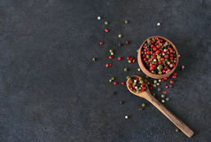 Black food background with spices. A mixture of peppers. Stock Photo
