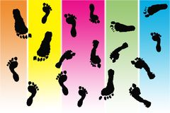 Black foot prints made by children. On gradient pastel stripes Stock Photo