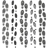 Black Footprints Silhouette Set. Vector Stock Photos