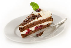 Black forest cake. On a plate isolated on white Stock Photo