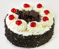 Black Forest Cake. Topped with whipped cream and cherries Stock Photography