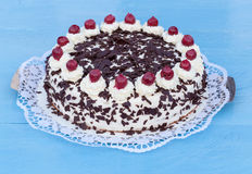 Black Forest cake on blue wood Royalty Free Stock Photos