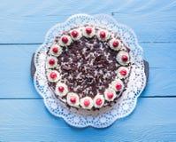 Black Forest cake on blue wood Stock Images