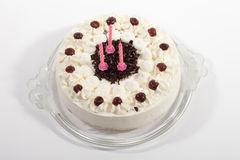 Black forest cake with candles, close-up Royalty Free Stock Photo