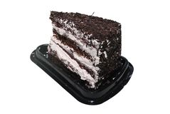 Black Forest cake with chocolate and white cream on the black plastic disposal stand stock photos