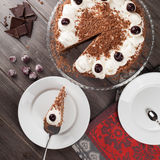 Black forest cake decorated with whipped cream and cherries. Royalty Free Stock Photography