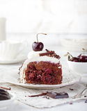 Black forest cake ,decorated with whipped cream and cherries Schwarzwald pie, dark chocolate Stock Photo