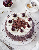 Black forest cake ,decorated with whipped cream and cherries Schwarzwald pie, dark chocolate Royalty Free Stock Photo