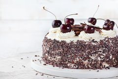 Black forest cake ,decorated with whipped cream and cherries Schwarzwald pie, dark chocolate and cherry dessert Royalty Free Stock Image