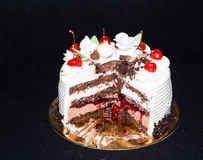 Black Forest cake. Black Forest layer cake on gold plate Royalty Free Stock Image