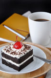 Black Forest Cake with Notebook and Coffee on Background Royalty Free Stock Photography