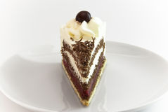 Black Forest cake piece. On plate frontal view royalty free stock photography