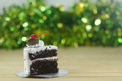 Black forest cake. A piece of  black forest cake with bokeh background Stock Photos