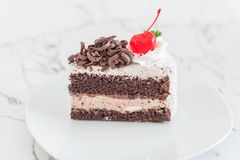 Black forest cake on  plate. Black forest cake on white plate Royalty Free Stock Image