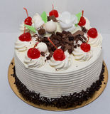 Black forest cake. Black forest cake, topped with whipped cream and cherries Royalty Free Stock Photo