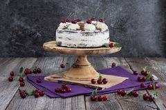 Black forest cake, or traditional austria schwarzwald cake from dark chocolate and sour cherries. On wooden table royalty free stock photos